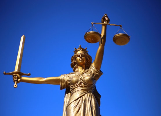 Lady holding Law scales and sword
